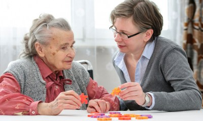 cognitive testing for Alzheimer's Disease with a senior woman